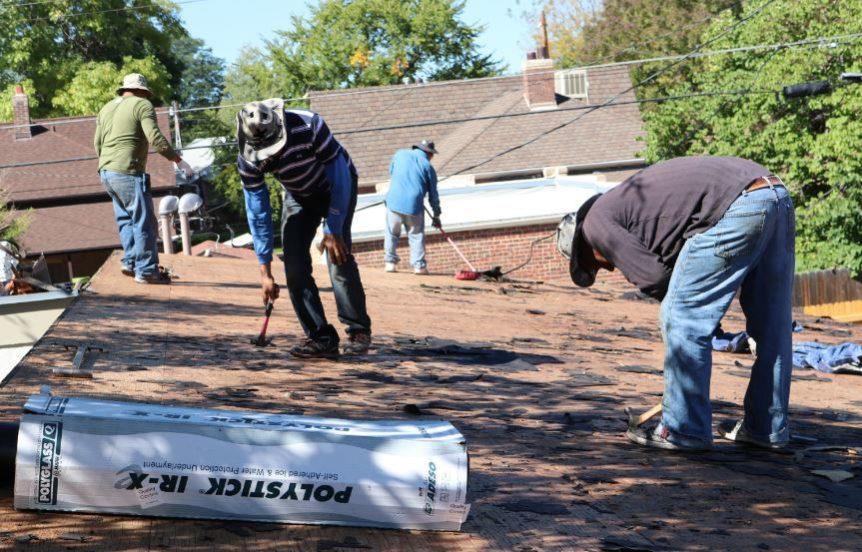 roofers working on preserving denver affordable housing