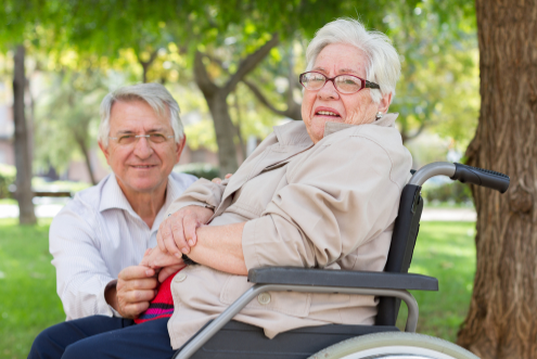 Senior couple woman in wheelchair